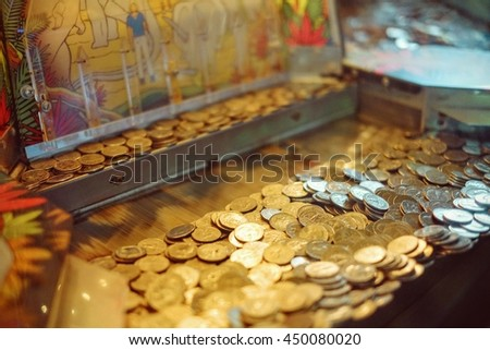 Quarter Coin Gambling Machine at Coney Island - stock photo