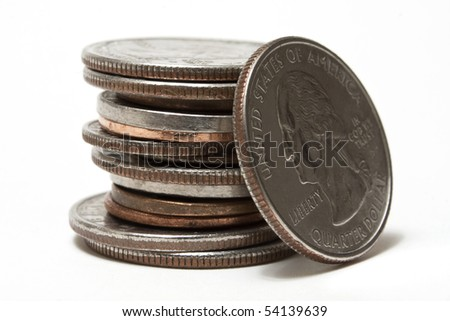 Quarter leaning on a stack of coins - stock photo