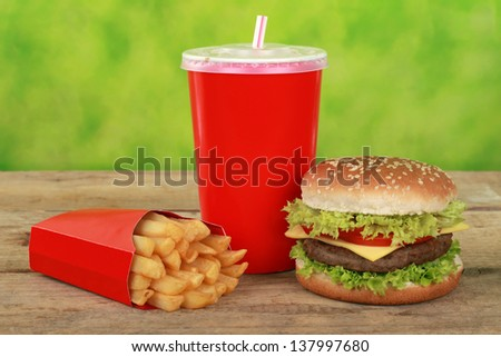 Quarterpounder combo meal with french fries and a cola drink - stock photo