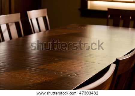 Quartersawn White Oak Table With Distressed Finish, Surrounded By Chairs,  In Front Of Window