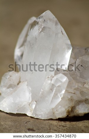 Quartz crystal mineral sample used for jewelry or manufacturing. - stock photo
