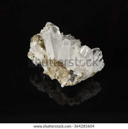 Quartz crystals in a Siderite groundmass.  The crystals are from the Galena Mine near Wallace Idaho