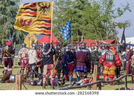 "QUATTRO CASTELLA, ITALY - MAY 17, 2015: warriors in medieval staged battle at festival ""RIEVOCANDUM1111"" A.D. 1557 devoted to the life in middle ages, on May 17, 2015 in Quattro Castella, Italy"