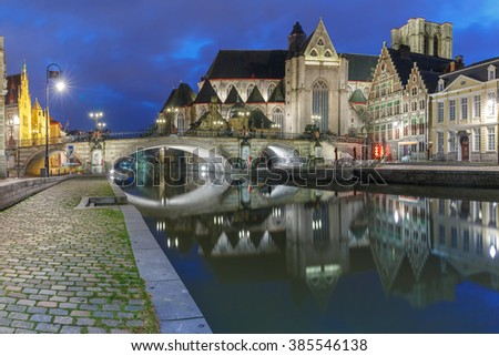 Quay Graslei, picturesque medieval St Michael's Bridge and church at night in Ghent, Belgium - stock photo