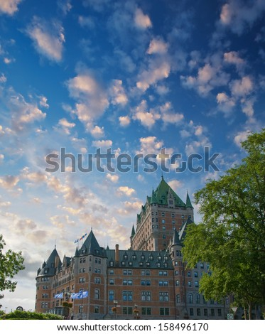 Quebec City. Beautiful view of Hotel de Frontenac with trees and sky. - stock photo