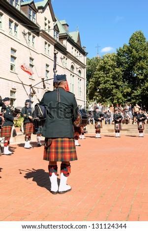 QUEBEC CITY, CANADA - AUGUST 16: Gagetown pipes and drums band on August 16, 2008 in Quebec City, Canada. Band plays in Place de l'Hotel de Ville for the 400th anniversary of founding of Quebec City