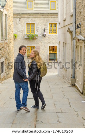 Quebec City, Canada - inter ethnic couple of tourist visiting old town - stock photo