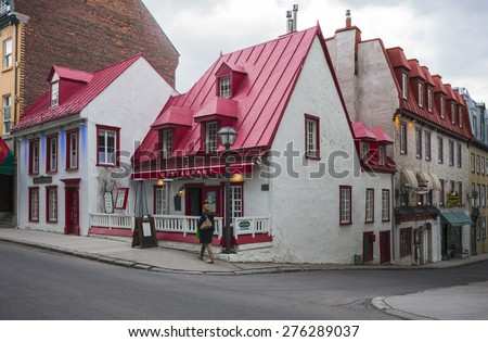 Quebec city, Canada - May 5 2014: Old houses and a restaurant in St Louis street