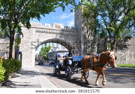 QUEBEC CITY, CANADA - SEP 10: Horse Carriage in front of St. Louis Gate on Sep 10, 2011 in Quebec City. The Old Quebec was declared a World Heritage site by UNESCO in 1985. - stock photo