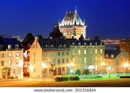 Quebec City old buildings with Chateau Frontenac at dusk  - stock photo