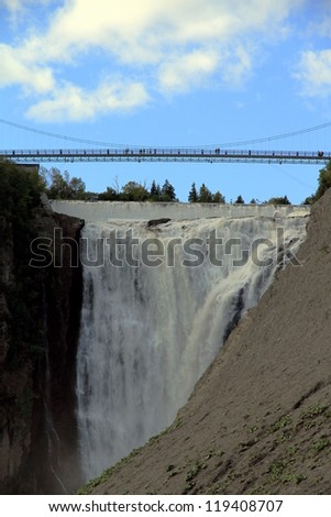 QUEBEC CITY - SEPTEMBER 10: The bridge over the Montmorency Falls on September 10, 2012 in Quebec City. The falls, at 84 meters (275 ft) high, are the highest in the province of Quebec.