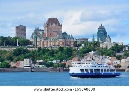 Quebec City skyline over river with blue sky and cloud. - stock photo