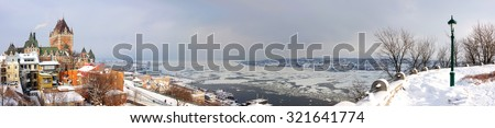 Quebec City skyline panorama with Chateau Frontenac viewed from hill during winter time - stock photo
