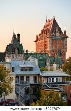 Quebec City skyline with Chateau Frontenac at sunset viewed from hill - stock photo