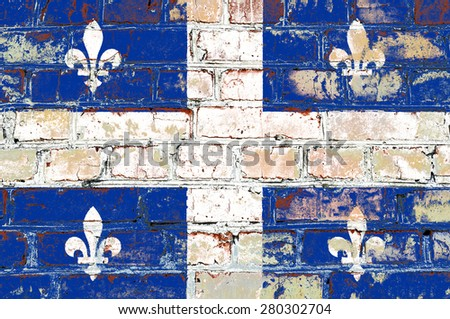 Quebec flag painted on old brick wall texture background - stock photo