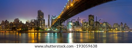 Queen Bridge and New York skyline - stock photo