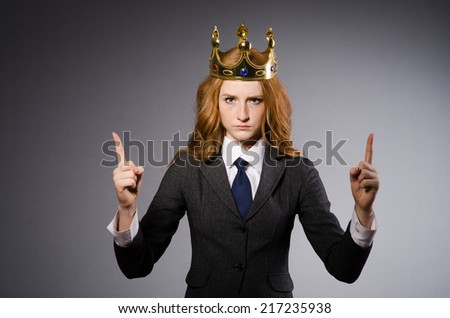 Queen businesswoman in funny concept - stock photo