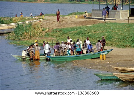QUEEN ELIZABETH NP, UGANDA - AUGUST 10: Fishermen at the Kazinga Channel on August 10, 2004 in Queen Elizabeth NP. The Kazinga Channel is natural channel, and is a dominant feature of National Park. - stock photo