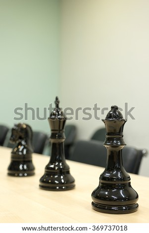 Queen, King and Knight of Chess on the table of  meeting room.