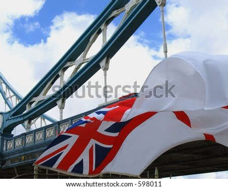 Queen's colours of the British Royal Navy flying close to Tower Bridge, London - stock photo