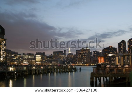 QUEENS, NEW YORK - JULY 4: View of Manhattan as seen from  Gantry Plaza State Park in Long Island City.   Taken July 4, 2015 in Queens, NY. - stock photo