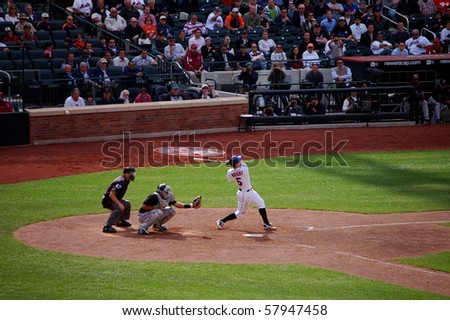 QUEENS, NY - APRIL 29: David Wright of the New York Mets fouls the ball back in a game against the Florida Marlins at Citi Field April 29, 2009 in Queens, NY - stock photo