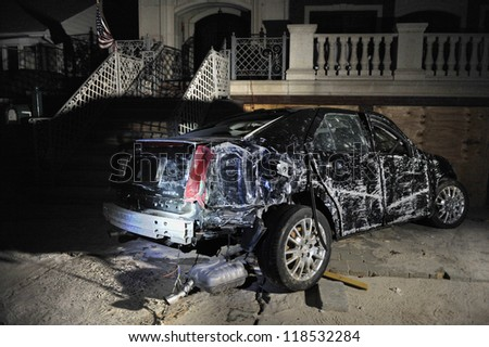 QUEENS, NY - NOVEMBER 11: Damaged car in the Rockaway due to impact from Hurricane Sandy in Queens, New York, U.S., on November 11, 2012.
