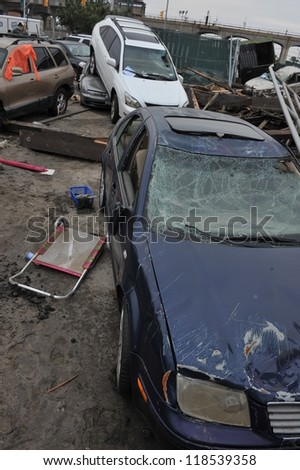 QUEENS, NY - NOVEMBER 11: Damaged cars at parking lot in the Rockaway due to impact from Hurricane Sandy in Queens, New York, U.S., on November 11, 2012.