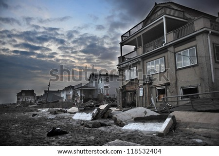 QUEENS, NY - NOVEMBER 11: Damaged houses without power at night in the Rockaway beach - Bel Harbor due to impact from Hurricane Sandy in Queens, New York, U.S., on November 11, 2012. - stock photo