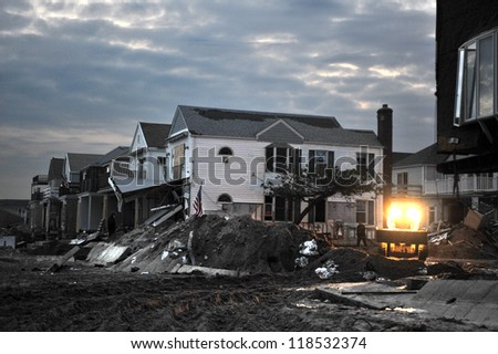 QUEENS, NY - NOVEMBER 11: Damaged houses without power at night in the Rockaway beach due to impact from Hurricane Sandy in Queens, New York, U.S., on November 11, 2012. - stock photo