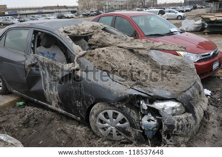 QUEENS, NY - NOVEMBER 11: Deamaged cars at parking lot in the Rockaway due to impact from Hurricane Sandy in Queens, New York, U.S., on November 11, 2012. - stock photo