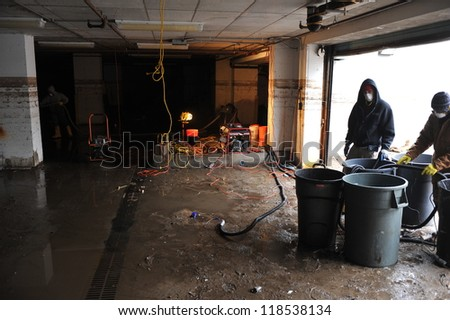 QUEENS, NY - NOVEMBER 11: Flooded basement and aftermath recovery in the Rockaway beach area houses due to impact from Hurricane Sandy in Queens, New York, U.S., on November 11, 2012. - stock photo