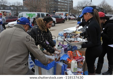 QUEENS, NY - NOVEMBER 11: People getting hep with hot food, clothes and supplies in the Rockaway due to impact from Hurricane Sandy in Queens, New York, U.S., on November 11, 2012. - stock photo