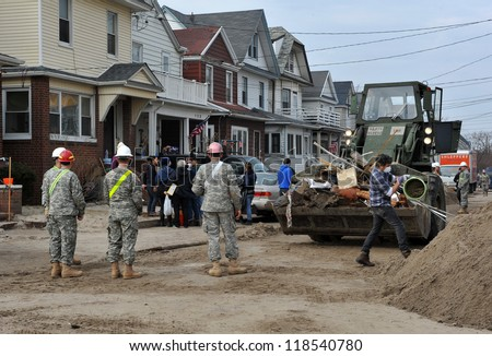 QUEENS, NY - NOVEMBER 11: U.S. Navy working on the streets ater massive destruction in the Rockaway Beach area due to impact from Hurricane Sandy in Queens, New York, U.S., on November 11, 2012.