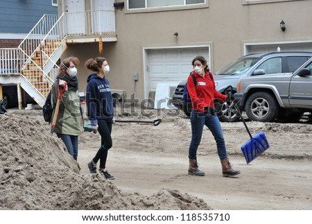 QUEENS, NY - NOVEMBER 11: Volunteers at parking lot in the Rockaway going home after cleaning work from Hurricane Sandy in Queens, New York, U.S., on November 11, 2012. - stock photo