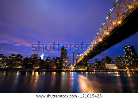 Queensboro Bridge and Manhattan skyline at dusk, New York City