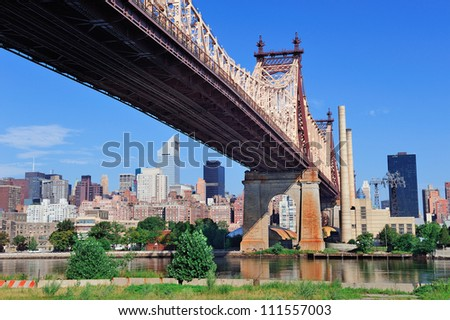 Queensboro Bridge in Midtown Manhattan with New York City skyline over East River as the famous landmarks viewed from Brooklyn.