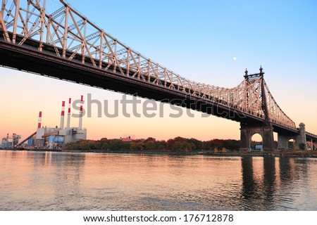 Queensboro Bridge over New York City East River at sunset viewed from midtown Manhattan. - stock photo