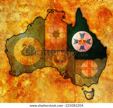 queensland flag on map of australia with administrative divisions - stock photo