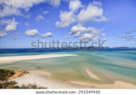 Queensland's Great Barrier reef Whitsunday islands Whiteheaven beach of pure silica white band and pristine emerald coral sea waters in aerial view on a sunny summer day - stock photo