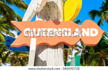 Queensland welcome sign with palm trees - stock photo
