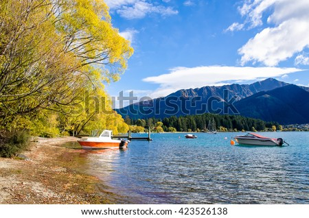 Queenstown,New Zealand - April 24,2016 : Boats parking at the jetty of Lake Wakatipu in Queenstown, New Zealand. - stock photo
