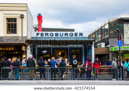 Queenstown,New Zealand - April 24,2016 : People can seen queuing and waiting their foods in front of the Fergburger's restaurant in Queenstown, New Zealand. - stock photo