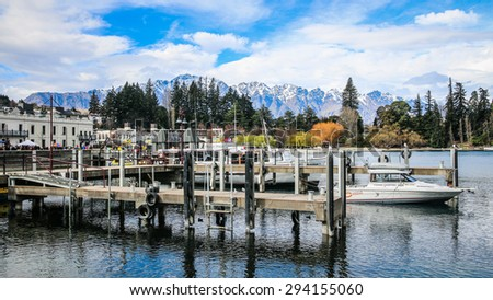QUEENSTOWN, NEW ZEALAND - AUGUST 29: Lake Wakatipu and The Remarkables in Winter - 29 August, 2013. Queenstown is the Southern Hemisphere's premier four season lake and alpine resort. - stock photo