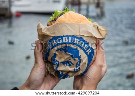 QUEENSTOWN, NEW ZEALAND-MAY 10, 2016 : Fergburger is a famous old brand of burger in this town - stock photo