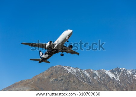 Queenstown, New Zealand - September 1: Air New Zealand plane takes off in Queenstown International Airport on September 1, 2014 in Queenstown, New Zealand.  - stock photo