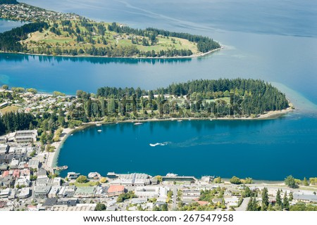 Queenstown on shores of Lake Wakatipu, an inland lake (finger lake) in the South Island of New Zealand - stock photo