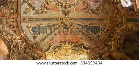 QUELUZ, LISBON, PORTUGAL - OCTOBER 26 2015: detail of the ceiling of the royal chapel at Queluz National Palace, on October 26, 2015, in Queluz, Lisbon, Portugal.