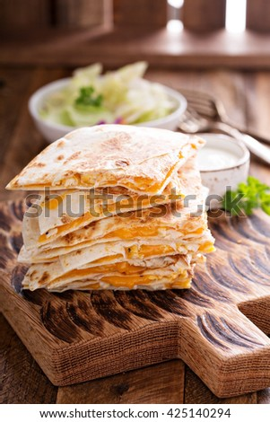 Quesadillas with cheddar and chicken with sauce - stock photo