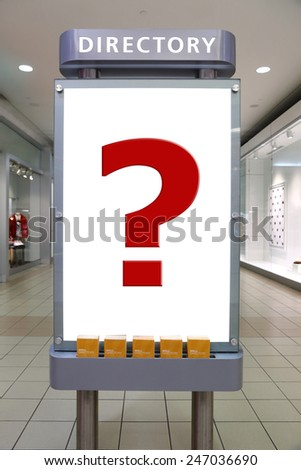 Question mark and direction sign inside shopping mall - stock photo